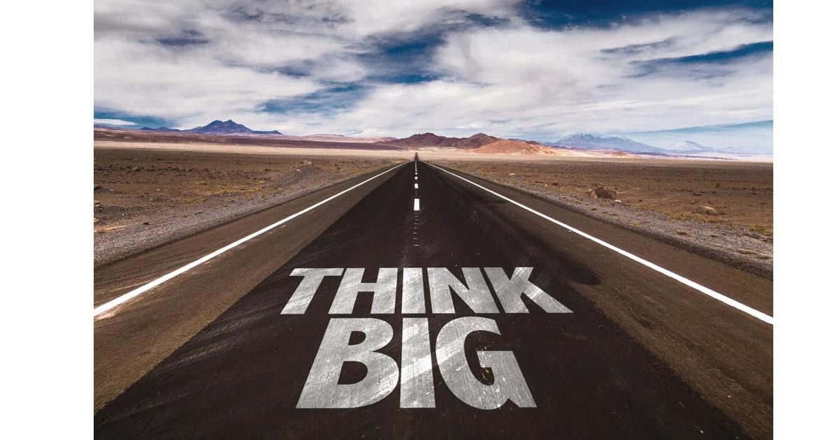 Think Big written on desert road